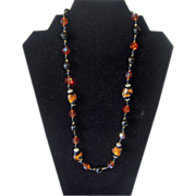 Vintage Black Beaded Necklace with Amber-Colored Foil Beads