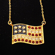 Vintage Signed Avon American Flag ~ gold-tone ~ garnet colored rhinestones for red strips ~ cl