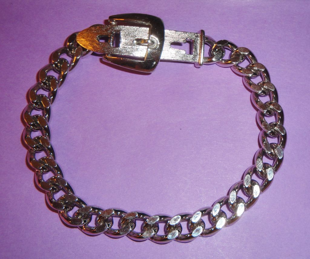 "Vintage Signed Avon 1974 Silver-tone ""Buckle Chain Bracelet"" ~ silver-tone flat-looped links with belt buckle closure"