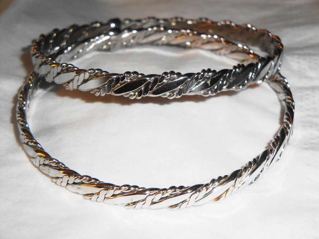 "TWO ~ Vintage Signed Avon 1979 ""Classic Twist Bangle Bracelets"" set in Silver-tone"