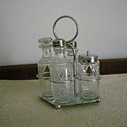 Vintage Small Four Bottles Cruet Set by C.W.S.