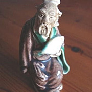Shekwan Chinese Mudman Figurine Early 20th Century Seated Gentleman with Fan