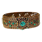 Czechoslovakia Gold Tone Metal Emerald Green Rhinestone Filigree Hinged Bangle Bracelet