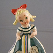Porcelain Little Girl with Ladybug Figurine