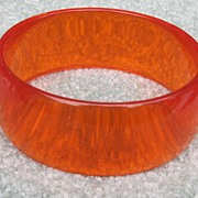 SOLD Orange Plastic Translucent Bangle