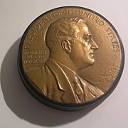 Bronze Disk With FDR in Profile Is Set On Top Of a Round LP Record ...