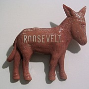 �Roosevelt� Is Written in White On a Small Terra Cotta Color Donkey Pin