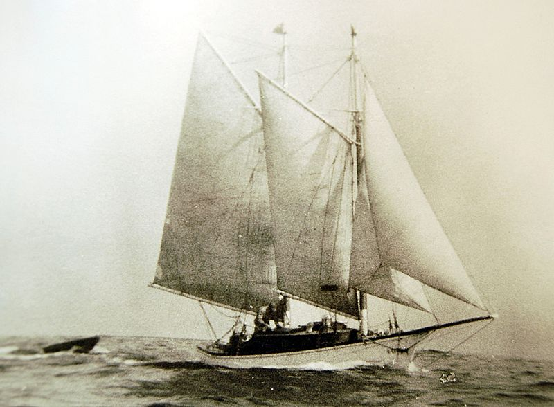Photograph Sailing Schooner Pulling Dinghy on High Seas Maine