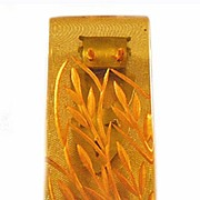 Bakelite Reverse Carved Apple Juice Dress Clip