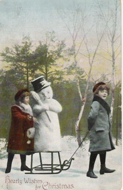 Real Photo Post Card with 2 Children Pulling Sled With Snowman