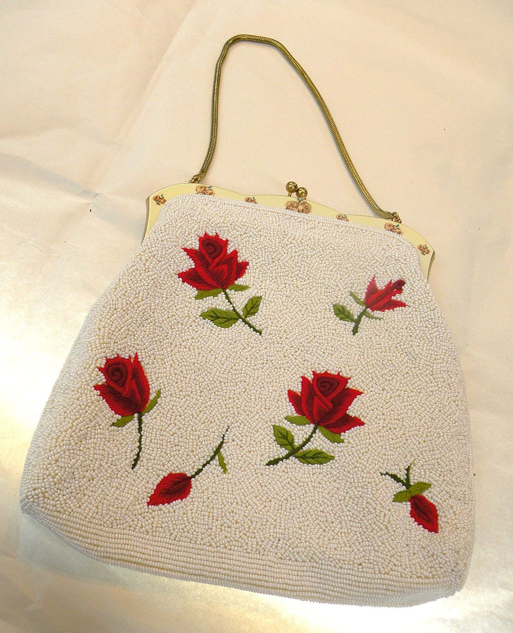 Red rose embroidered and ivory colored beaded purse with