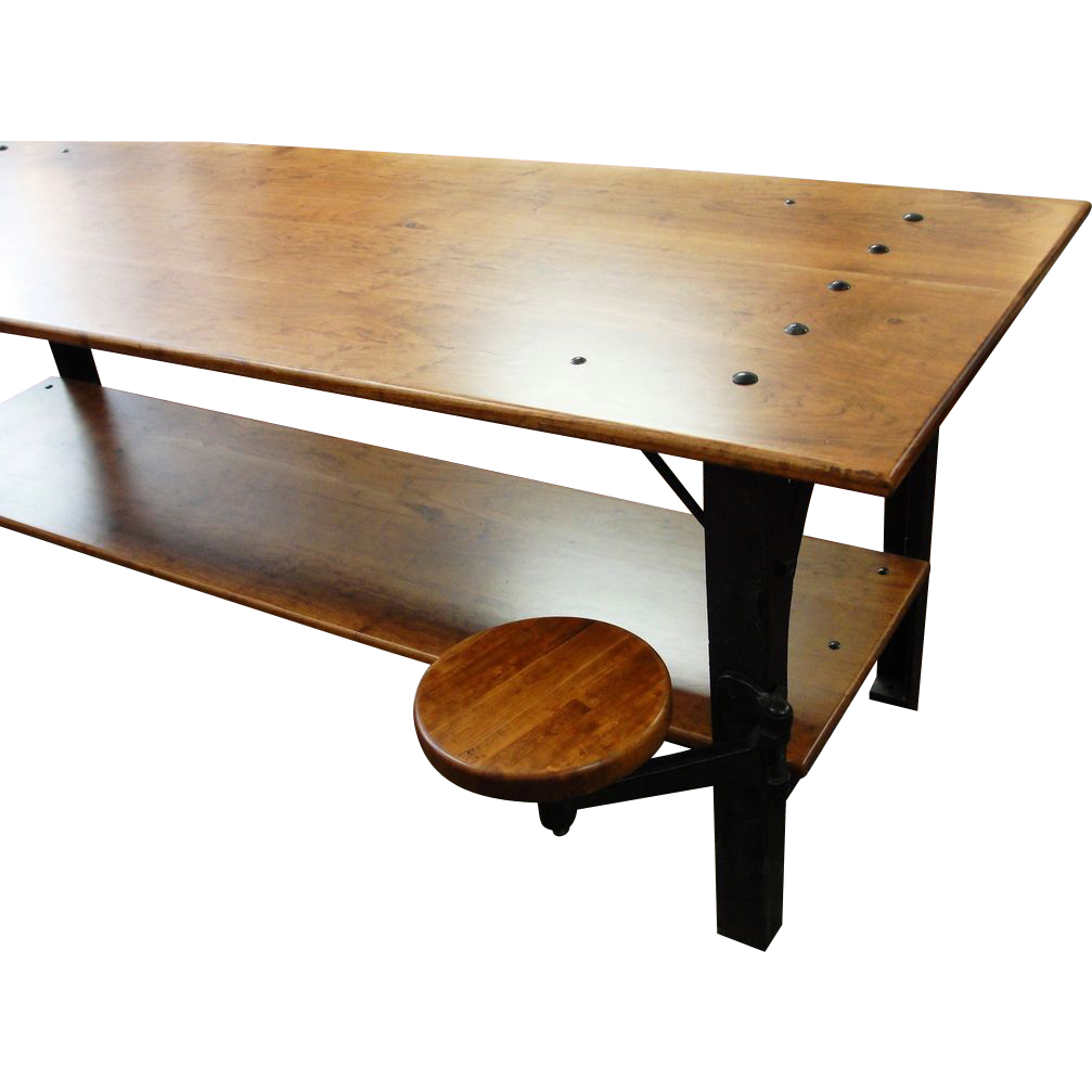 Industrial table with cast iron legs and swing out stool from