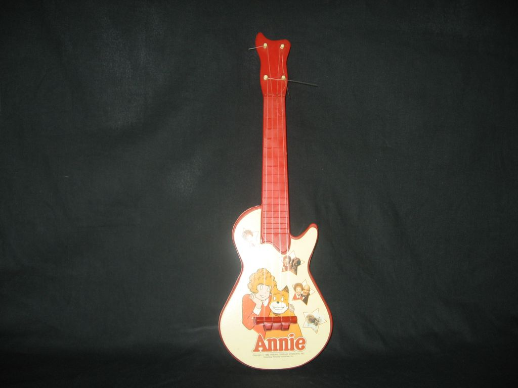 1982 Little Orphan Annie plastic toy guitar