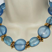 Pretty Blue Lucite Bead Necklace with Goldtone Ring Spacers.