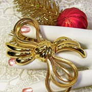 SALE Monet High Polish Gold-tone Serpentine Bow Pin