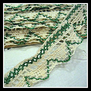 Dainty crocheted Lace with green weaving - 3+ yards - 7/8 inch wide