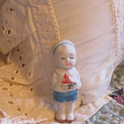 Vintage Bisque Boy Doll With Sail Boat
