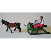 4 Piece Metal Lead Toy Sleigh Horse and People