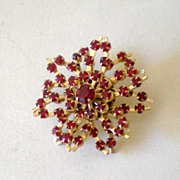 Sparkly Gold and Red Stones Starburst Brooch