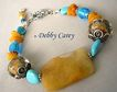 Yellow Calcite, Borosilicate & Venetian Lampwork, Kingman Turquoise, Baltic Amber, & Bali Sterling Silver Bracelet