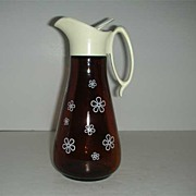 Brown glass syrup container w/ white daisy design