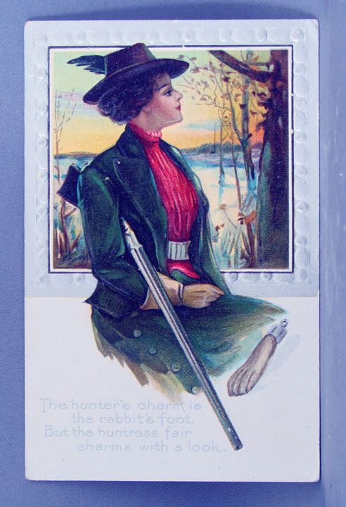1910 Huntress with rifle and rabbit's foot