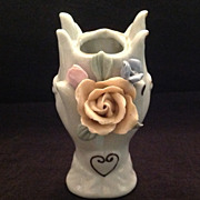 Glazed bisque hand vase with high relief applied flowers