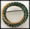Dazzling Emerald Green and Goldtone Rope Circular Rhinestone Pin/Brooch.