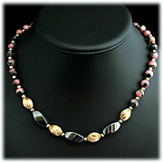 Rhodonite and Hematite Necklace with Gold Colored Beads