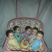 Vintage Madame Alexander Dionne Quintuplet Composition Dolls in Wicker buggy