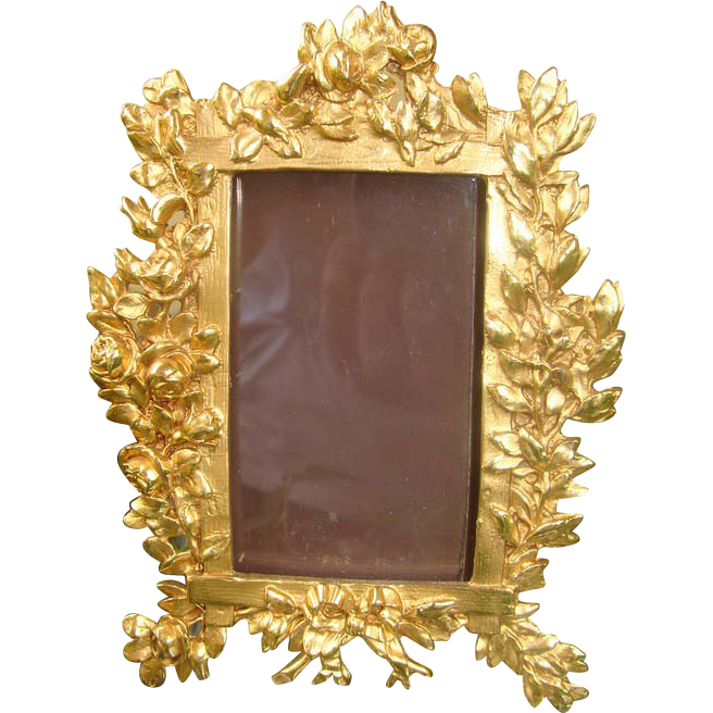 Antique gilded metal frame with rich decoration