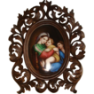 Handpainted porcelain miniature depicting Our Lady of the table set in a fine carved Florentine wooden frame