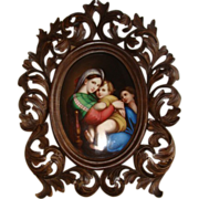 Handpainted porcelain miniature depicting Our Lady of the table set in a fine carved Florentin