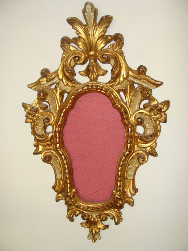 An antique Italian carved gilt  wood mirror frame, 19th century