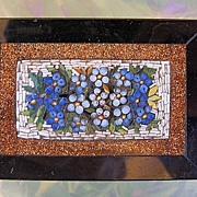 Antique Micro Mosaic paperweight depicting blue flowers and green leaves