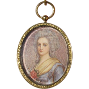Antique Miniature portrait of a young lady set in yellow gold, dated at the 19th ...