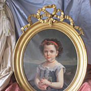 Portrait of a young girl, oil on canvas,signed Van Tarys and dated 1875