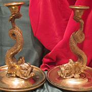 French Empire Gilt Bronze candle sticks modelled and cast as two  dolphins,early 19th century