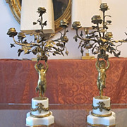 A pair of French  Gilt Bronze five-light figural candelabra, 19th century