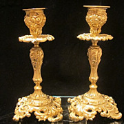 Elegant pair of Rococo Style brass candle sticks, 19th century