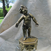 Bronze figure modelled and cast as a little boy standing on an adorned base, 19th century
