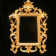 Antique gilded metal  frame with c-scroll adornment,19th century