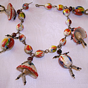 Unusual Folk Art Shell, Seed, & Bead People Charm Bracelet