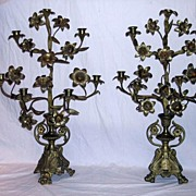 Circa 1875.  Pair of striking,  large, seven arm candelabra in cast brass or bronze