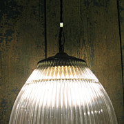 One of Ten Vintage Clear Holophane Shade Pendant Rewired and Hung on Steel Cable w/ Braided Bl