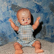 "Cute 8"" Celluloid Baby Boy with Original Clothes"