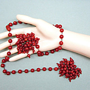 Persimmon Red Bakelite Beaded Tassel Lariat Necklace Beaded on wire.