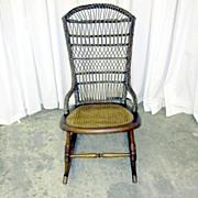 Antique Brown Wicker and Cane Rocking Chair in Near Mint Condition Walnut Frame