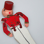 Vintage Plastic Buddy Bell Hop Brooch