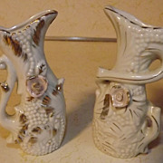 SOLD Two white Japan bud vases urns with raised flowers